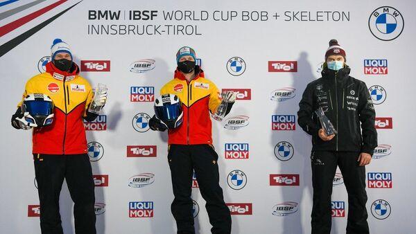 Тройку призеров сумел разбавить только латвийский дуэт во главе с Оскарсом Киберманисом (справа) - Sputnik Латвия