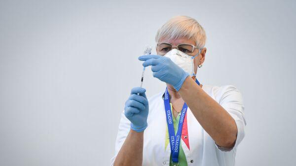 Пункт вакцинации от COVID-19 в Риге - Sputnik Latvija