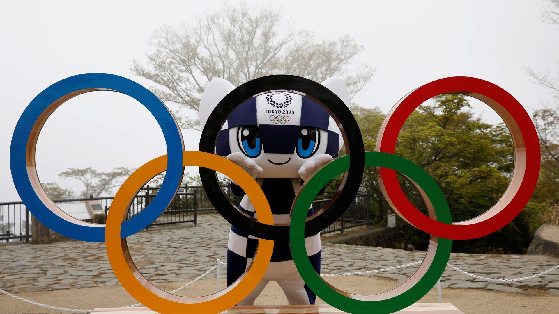 Олимпийские кольца и талисман Олимпиады-2020 в Токио - Sputnik Латвия, 1920, 19.07.2021
