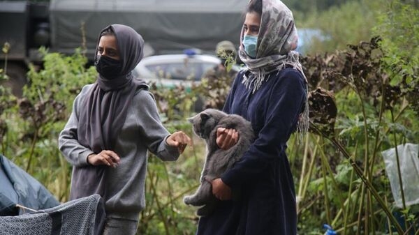 Афганские беженцы на польско-белорусской границе, 1 сентября 2021 года - Sputnik Latvija