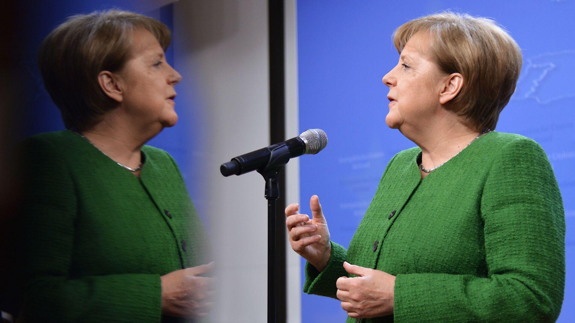 Канцлер Германии Ангела Меркель во время саммита ЕС в Брюсселе - Sputnik Латвия, 1920, 28.09.2021