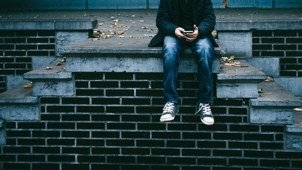 Молодой человек на лестнице - Sputnik Latvija