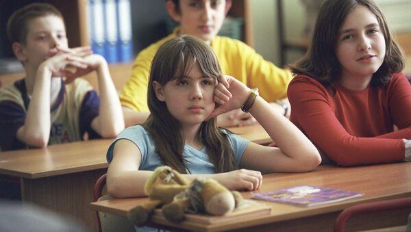 Школьники на уроке - Sputnik Латвия