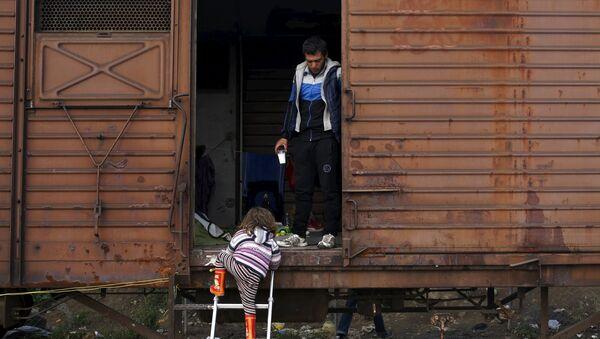Беженцы в вагоне поезда - Sputnik Latvija