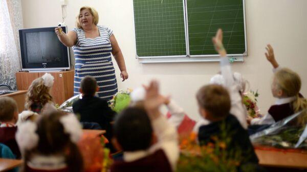 Ученики на уроке - Sputnik Латвия