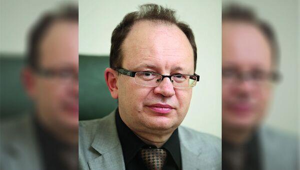 Артурс Утинанс, врач-психиатр, доцент, психотерапевт, врач клиники психосоматической медицины и психотерапии при Рижском университете имени Страдиня - Sputnik Латвия