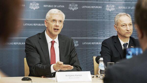 Премьер-министр Кришьянис Кариньш и министр юстиции Янис Борданс - Sputnik Latvija
