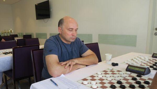 Латвийский мастер по стоклеточным шашкам Гунтис Валнерис - Sputnik Латвия