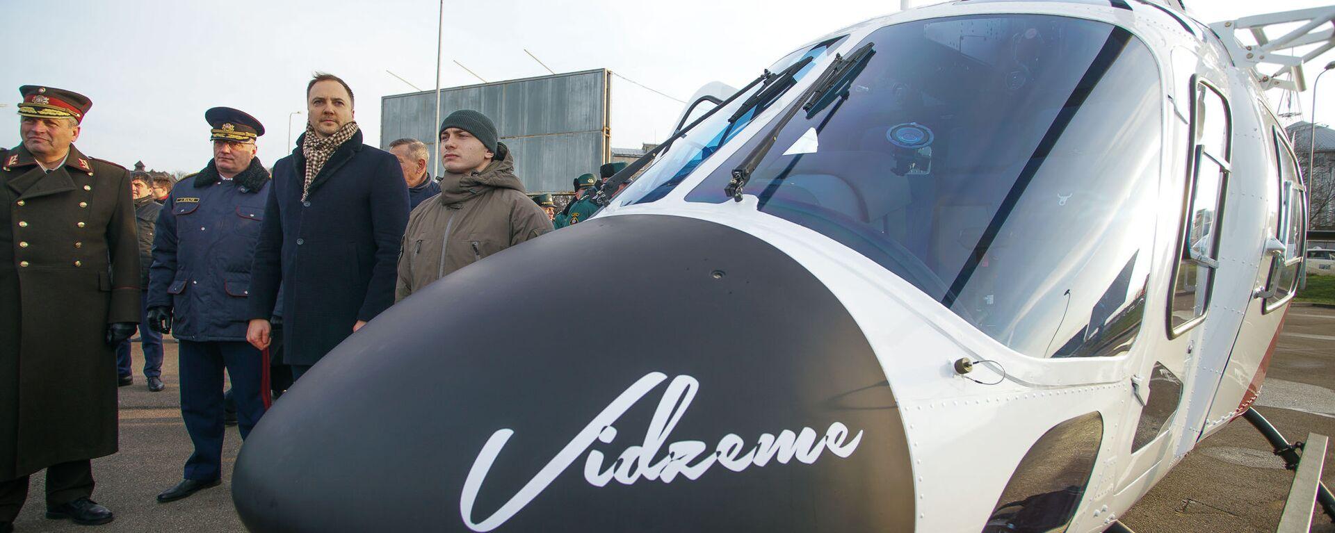 Глава МВД Латвии Сандис Гиргенс на церемонии приемки вертолетов AW 119 Kx - Sputnik Латвия, 1920, 02.11.2020