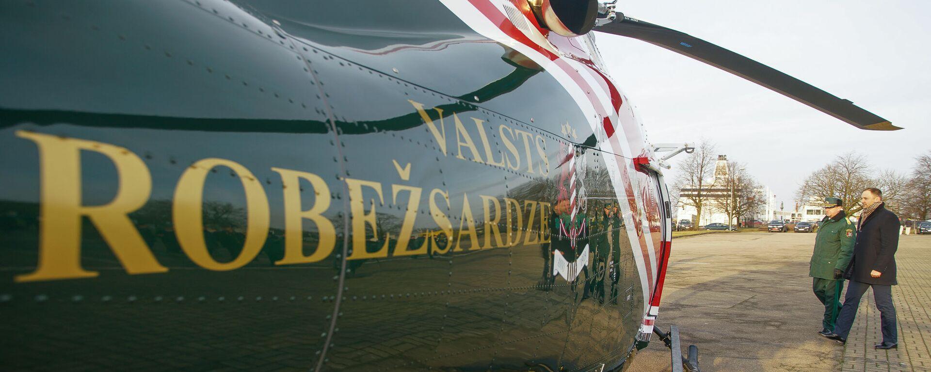 Глава МВД Сандис Гиргенс на церемонии приемки новых вертолетов AW 119 Kx  - Sputnik Латвия, 1920, 06.03.2020