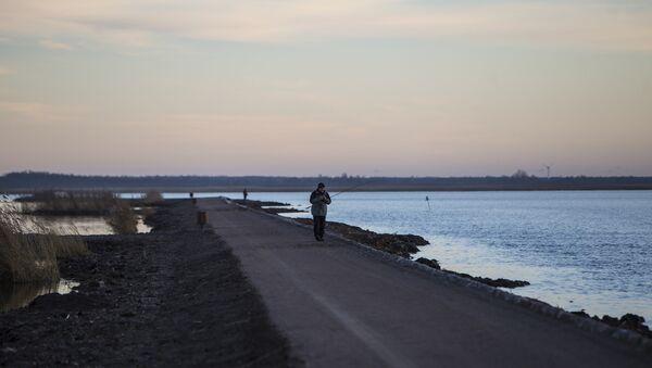 Рыбак на море - Sputnik Латвия