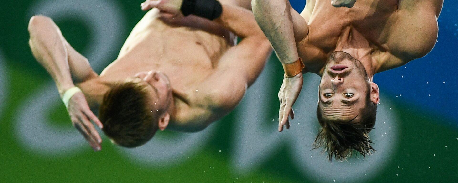 Олимпиада 2016. Синхронные прыжки в воду. Мужчины. Вышка 10 м - Sputnik Латвия, 1920, 22.05.2020