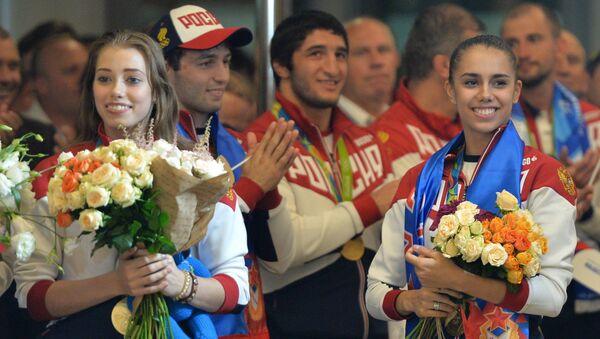 Встреча золотого рейса с чемпионами и призерами XXXI Олимпийских игр - Sputnik Latvija