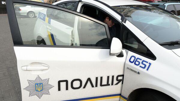 Сотрудник украинской полиции в Киеве - Sputnik Latvija