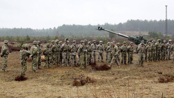 Военные учения НАТО на полигоне Адажи в Латвии. Архивное фото - Sputnik Латвия