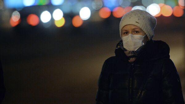 В защитной маске - Sputnik Латвия