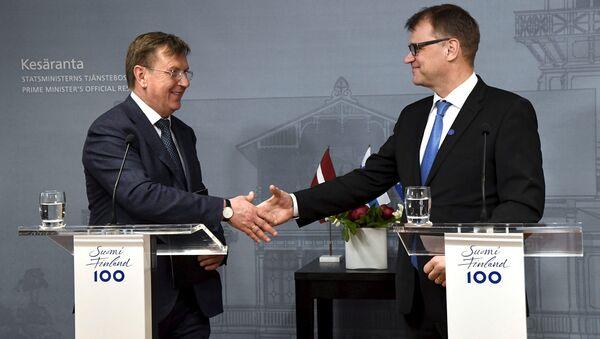 Latvijas premjerministrs Māris Kučinskis un Somijas valdības vadītājs Juha Sipile - Sputnik Latvija