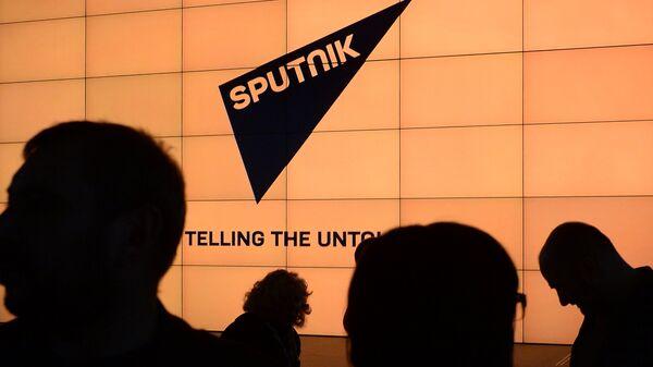 Логотип международного информационного бренда Sputnik - Sputnik Латвия