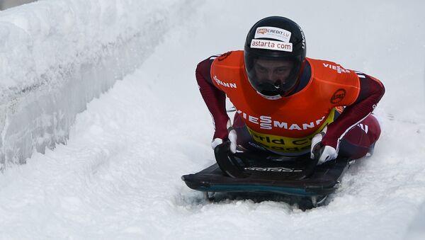 Мартинс Дукурс во время соревнований по скелетону - Sputnik Латвия