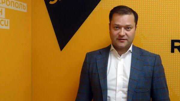 Директор Института актуальной экономики Никита Исаев - Sputnik Латвия