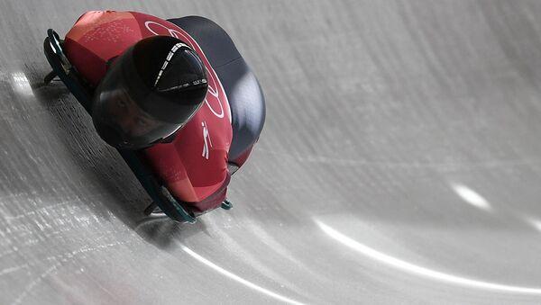 Мартинс Дукурс (Латвия) во время соревнований по скелетону среди мужчин на XXIII зимних Олимпийских играх - Sputnik Латвия