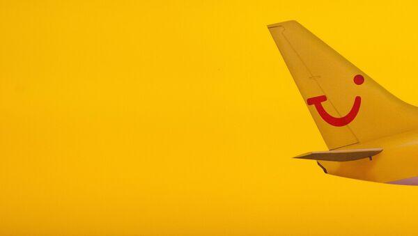 Логотип туроператора TUI на хвосте самолета - Sputnik Латвия