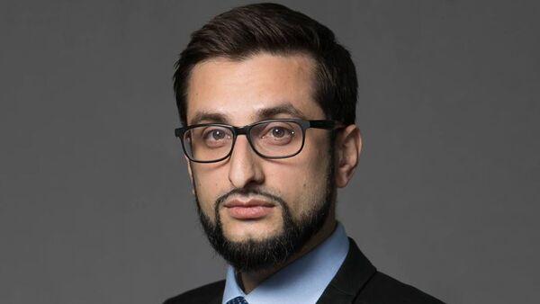 Эксперт по блокчейн-технологиям и криптоэкономике, управляющий партнер MINDSMITH Руслан Юсуфов - Sputnik Латвия