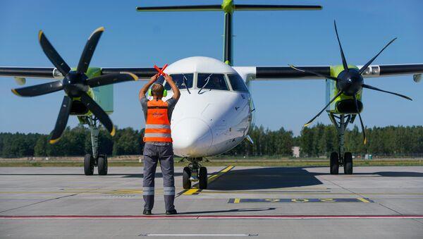 Самолет Bombardier Q400 NextGen авиакомпании airBaltic в аэропорту Рига - Sputnik Латвия